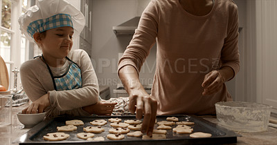 Buy stock photo Cropped shot of a woman and her daughter baking cookies at home