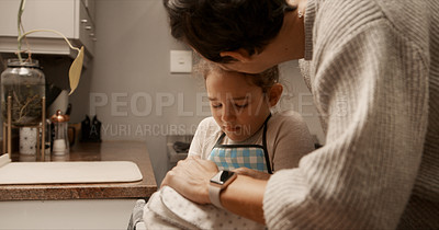 Buy stock photo Cropped shot of a woman comforting her daughter after she injured her hand