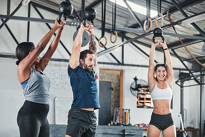 Buy stock photo Cropped shot of a group of young athletes in an exercise class at the gym