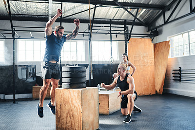 Buy stock photo Shot of a man doing box jumps at the gym