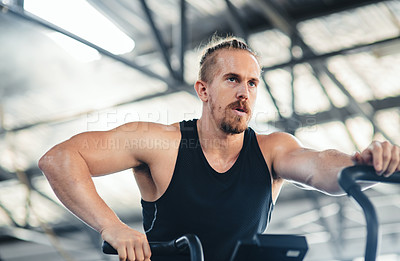Buy stock photo Shot of a man doing cardio at the gym