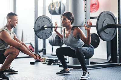 Buy stock photo Shot of a young woman working out with a barbell at the gym