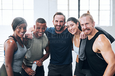Buy stock photo Portrait of a group of young athletes standing together in the gym