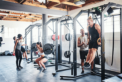 Buy stock photo Shot of a group of people working out at the gym