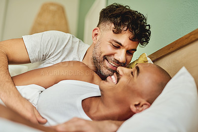 Buy stock photo Shot of an affectionate couple lying in bed together