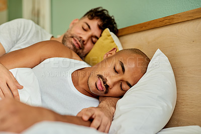 Buy stock photo Shot of a young couple sleeping in their bed at home