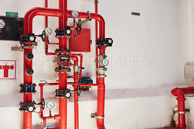 Buy stock photo Shot of a fire sprinkler system in a building