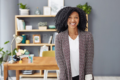 Buy stock photo Portrait of a young businesswoman standing in her office