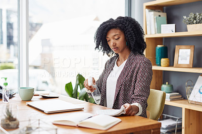 Buy stock photo Shot of a businesswoman cleaning her desk