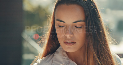 Buy stock photo Cropped shot of a beautiful young woman standing outside in the city