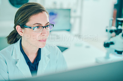 Buy stock photo Shot of a scientist using a computer while conducting research in a laboratory