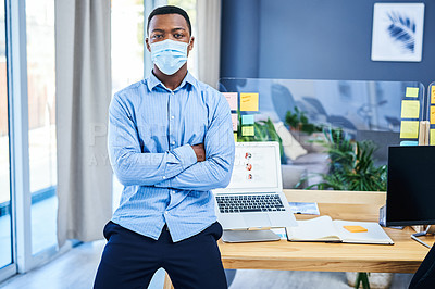 Buy stock photo Portrait of a young businessman wearing a face mask in an office