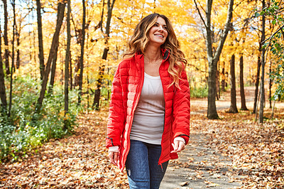 Buy stock photo Cropped shot of an attractive young woman in the forest during autumn