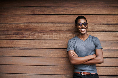 Buy stock photo Portrait of a stylish young man standing against a wooden background