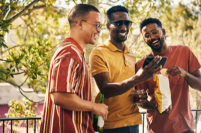 Buy stock photo Cropped shot of a group of friends having drinks while looking at something on a cellphone