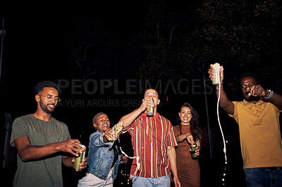 Buy stock photo Shot of a group of friends out partying at night