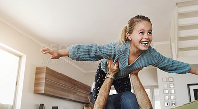 Buy stock photo Shot of an adorable little girl having fun with her father at home