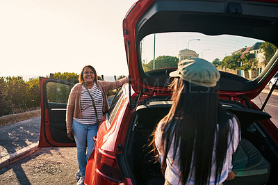 Buy stock photo Shot of a woman and her daughter arriving at the beach with their car