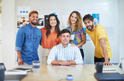 Buy stock photo Portrait of a group of young businesspeople having a meeting in a modern office