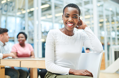 Buy stock photo Shot of a young businesswoman having a meeting with her team in a modern office