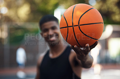Buy stock photo Portrait of a sporty young man standing on a basketball court