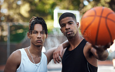 Buy stock photo Portrait of two sporty young men standing on a basketball court