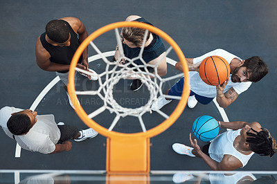 Buy stock photo High angle shot of a group of sporty young men playing basketball on a sports court