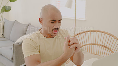 Buy stock photo Shot of a young man looking stressed while working from home