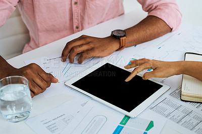 Buy stock photo Closeup shot of two unrecognisable businesspeople using a digital tablet while having a meeting in an office