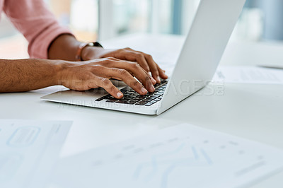 Buy stock photo Closeup shot of an unrecognisable businessman working on a laptop in an office