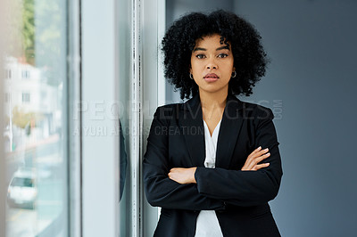 Buy stock photo Shot of a confident young businesswoman working in a modern office