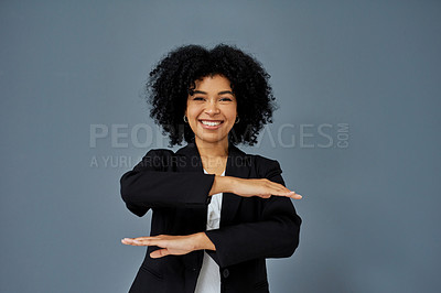 Buy stock photo Shot of young businesswoman advocating for equality against a grey studio background