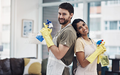 Buy stock photo Shot of a happy young couple getting ready to disinfectant their home