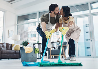 Buy stock photo Shot of an affectionate young couple mopping the floor together at home