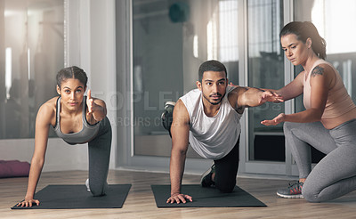 Buy stock photo Shot of two young athletes working out with their coach