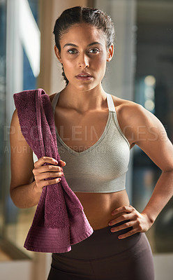 Buy stock photo Cropped portrait of an attractive young female athlete standing with her hand on her hip in the gym