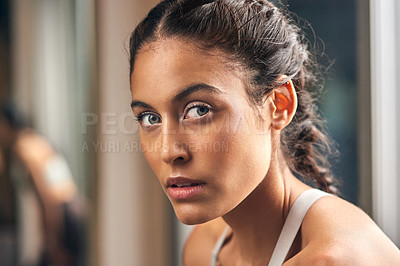 Buy stock photo Cropped portrait of an attractive young female athlete in the gym
