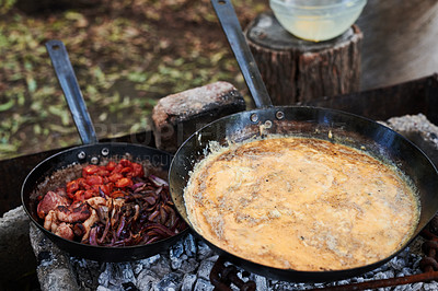 Buy stock photo Shot of breakfast being prepared on a grill outdoors