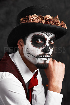Buy stock photo Cropped portrait of a handsome young man dressed in his Mexican-style halloween costume