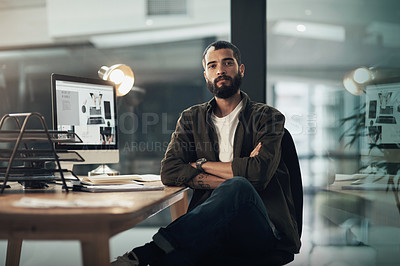 Buy stock photo Portrait of a confident young businessman working late at night in a modern office