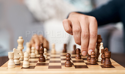 Buy stock photo Shot of an unrecognisable man playing a game of backgammon at home