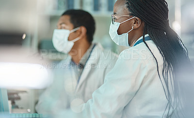 Buy stock photo Shot of a scientist working alongside a colleague in a lab