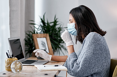 Buy stock photo Shot of a masked young woman coughing while working from home