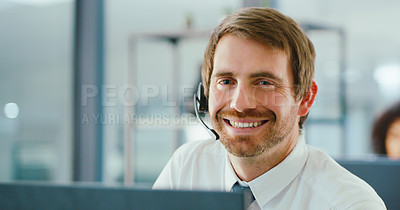 Buy stock photo Shot of a confident young man using a headset and computer in a modern office