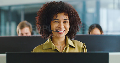 Buy stock photo Shot of a confident young woman using a headset and computer in a modern office