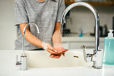 Buy stock photo Closeup shot of an unrecognisable woman washing her hands
