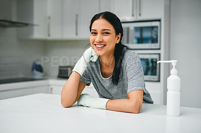 Buy stock photo Portrait of a young woman cleaning her home