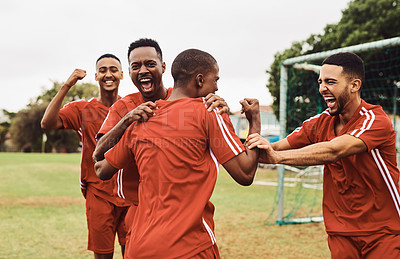 Buy stock photo Shot of a team of soccer players celebrating their victory while out on the field