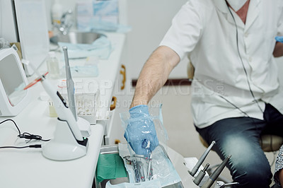 Buy stock photo Shot of a dentist performing a procedure on a patient
