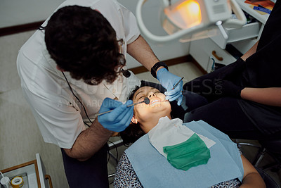 Buy stock photo Shot of a young woman having dental work done on her teeth